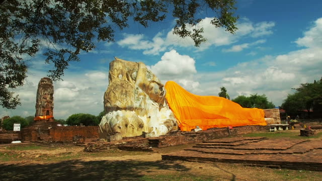 Lone Buddhist enormous statue of the Buddha at Ayutthaya Historical Park in Thailand.