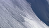 WS, Lone skier watching avalanche on steep mountainside, Cariboo and Monashee Mountains, British Columbia, Canada