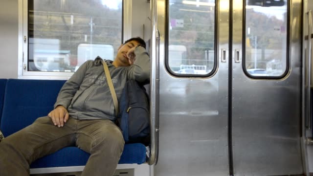 lonely and tired men in subway