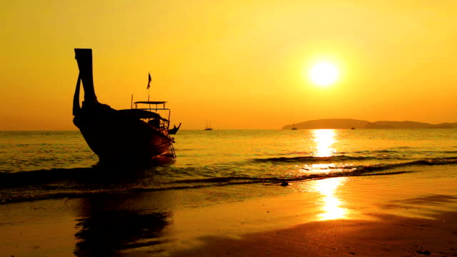 Lonely boat and beautiful sunset at the sea
