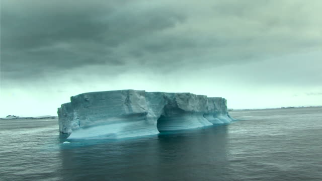 lonely iceberg with ominous sky
