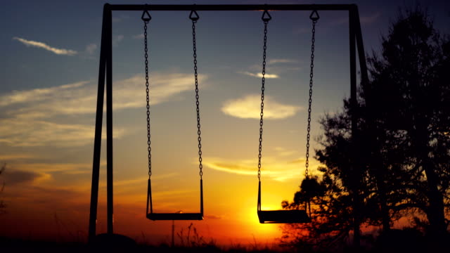 Lonely swings at sunset