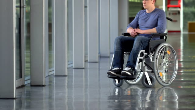 LS PAN Lonely Young Man In Wheelchair