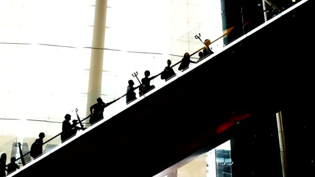 Long escalators in silhouette