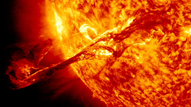 / long filament of solar material that had been hovering in the sun's atmosphere the corona erupts out into space Enormous solar flare erupts from...