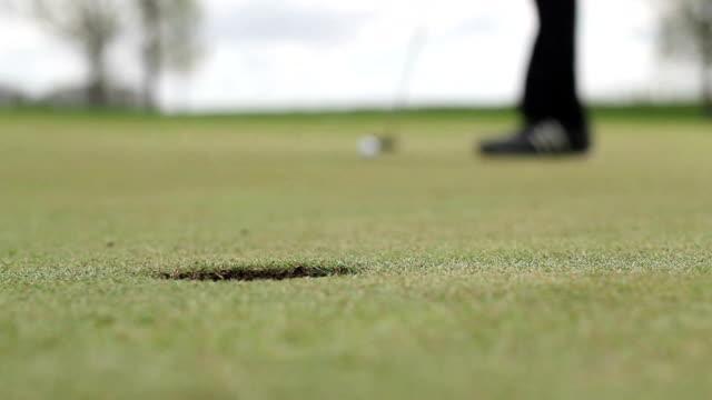 Long Golf Putt into Hole
