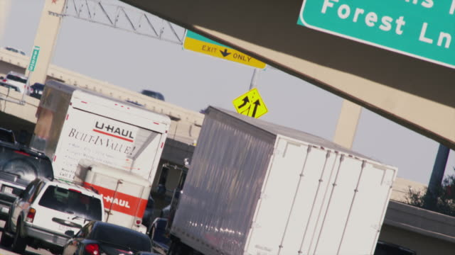Long lens, graphic angle, huge traffic congestion on hot interstate highway.