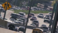 Long lens, overhead, huge traffic congestion on hot interstate highway.