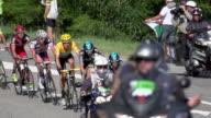Long lens shot of Bradley Wiggins climbing amidst team sky on stage 11 of the 2012 Tour de France
