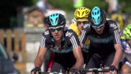 Long lens shot of Richie Porte Chris Froome leading Bradley Wiggins followed by Cadel Evans on a climb in stage 11 of the 2012 Tour de France