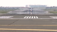 Long Lens View of the Runway as an aircraft lands