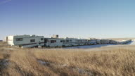 Long line of trailers outside of fracking town Williston, North Dakota, USA.