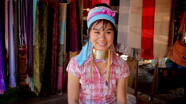 Long neck karen women show Thailand's greeting style