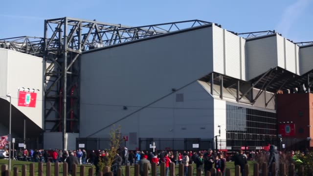 Long panning shot of fans in front of Anfield Stadium Liverpool v Swansea on February 17 2013 in Liverpool England