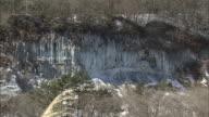 Long pillars of ice hang from two frozen waterfalls in Japan.