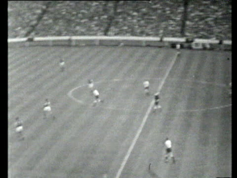 Long punt from goalkeeper finds Jimmy Greaves brilliant individual skill sees Greaves dribble inside wrong footing three defenders before coolly...
