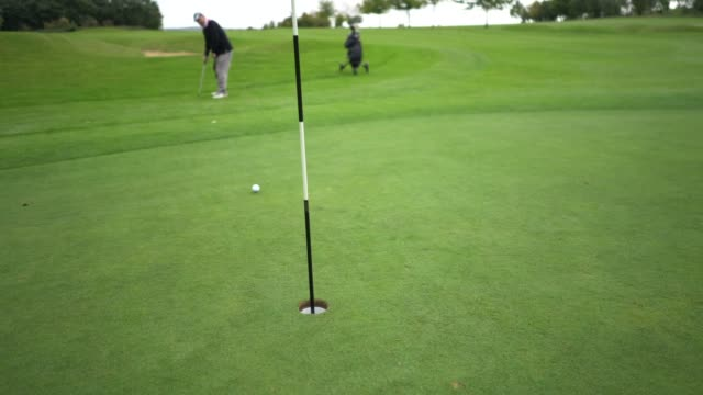 A long putt in the hole.