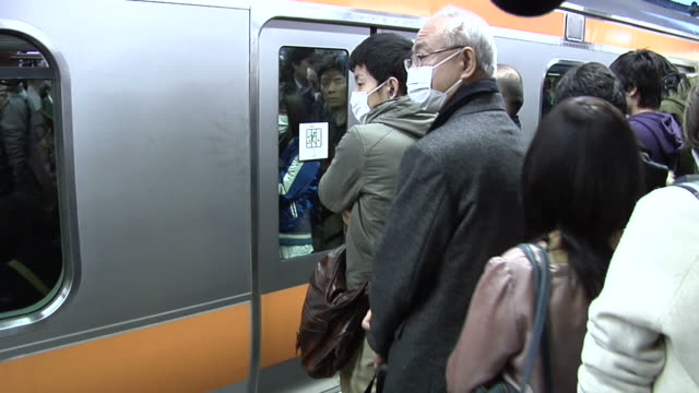 Long queue of Commuters waiting for a ride home on JR Chuo Line in Shinjuku