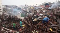 Long Shot a group of children is making their way though tons of rubble Typhoon Haiyan which ripped through Philippines on November 9 has been...