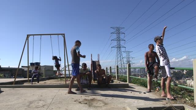 Long Shot a group of local friends General views of Morro da Sao Carlos favela in Rio de Janeiro Brazil on June 5 2013