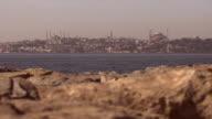 Long shot across the Bosphorus towards the city of Istanbul.