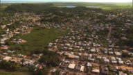 Long Shot aerial tracking,right , Houses crowd a neighborhood in Puerto Rico. / Puerto Rico