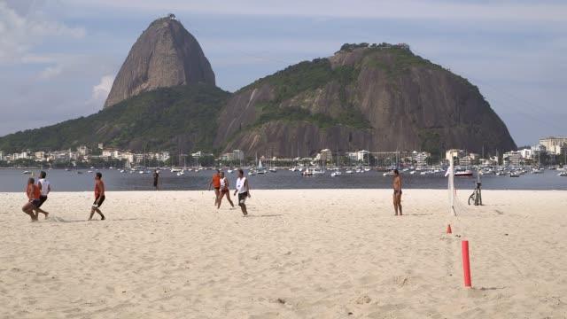 Long Shot amateur teams play play football on Botafogo Beach Rio de Janeiro Brazil on June 9 2013
