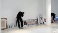 Long Shot artworks featuring in the seventh annual Macmillan De'Longhi Art Exhibition are hung in the Royal College of Arts on September 18 2013 in...