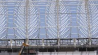 Long Shot construction workers on the roof of Estadio BeiraRio in Porto Alegre Home to the Sport Club Internacional one of Brazil's biggest clubs the...
