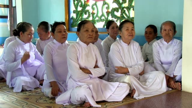 Long shot Elderly women worshippers of Cao Dai religion attending a mass Shot on January 2016