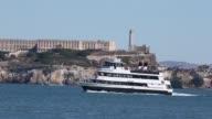 Long Shot ferries passing by Alcatraz Island