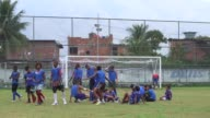 Long Shot football warm up Youngsters train and play football in Vila Alianca Rio de Janeiro Brazil on June 12 2013