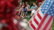 Long shot local resident watch the 4th of July Parade along the parade route Takoma Park July 4 2013
