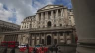 Long Shot Members of the public walk past the Bank of England in the City of London on September 18 2013 in London England The Bank of England's...