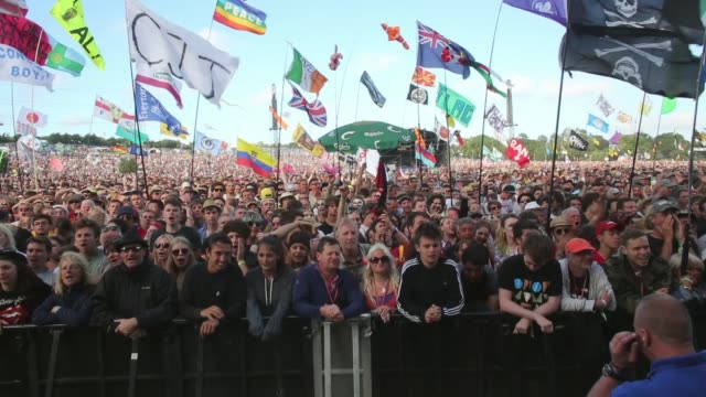 Long shot of a crowd watching a band