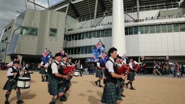 Long shot of a marching band performing before the AFL Anzac Day match between the Essendon Bombers and the Collingwood Magpies outside of the...