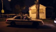 Long shot of a police car at the scene of the shooting Police collect evidence at the scene of a shooting on June 23 2013 in Chicago Illinois A man...
