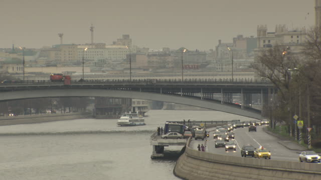 Long shot of a river running through the city of Moscow.