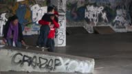 Long shot of a skater helping a young boy to perform his first trick Skateboarding's South Bank Home Under Threat at Southbank Centre on May 18 2013...