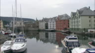 Long shot of boasts moored in a harbour at Alesund.