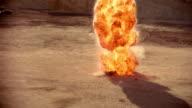 Long shot of car with trunk open stranded in desert / exploding / burning
