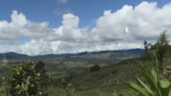 Long shot of clouds drifting across the beautiful Western Highlands province of Papua New Guinea.