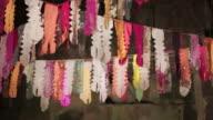 Long shot of colourful paper ribbons strung up at the Angkor Wat Temple, Cambodia.