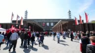 Long shot of fans heading towards the stadium entrance 1 FC Koeln v TSV 1860 Muenchen 2 Bundesliga Editorial Video Footage at RheinEnergieStadion on...