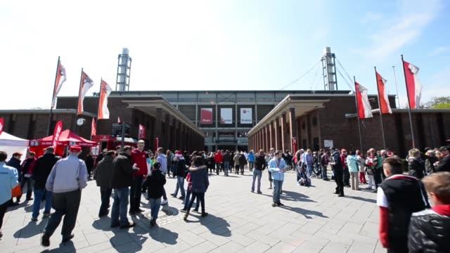 Long shot of fans heading towards the stadium entrance 1 FC Koeln v TSV 1860 Muenchen 2 Bundesliga Editorial Video Footage at RheinEnergieStadion on...