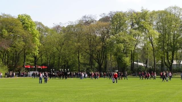 Long shot of fans walking through the park close to the stadium 1 FC Koeln v TSV 1860 Muenchen 2 Bundesliga Editorial Video Footage at...