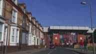 Long shot of fans walking towards Anfield Stadium Liverpool v Swansea on February 17 2013 in Liverpool England