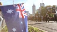 Long shot of passing parade Long shot of passing parade Australians on April 25 2013 in Various Cities Australia
