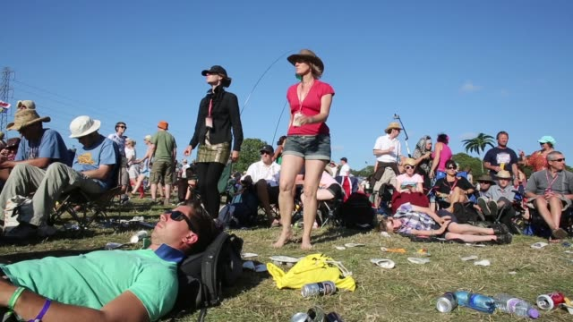 Long shot of people dancing and sleeping at the festival