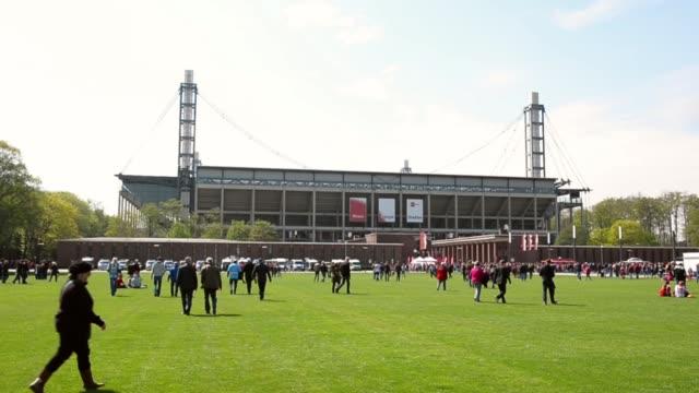 Long shot of stadium exterior view from nearby park 1 FC Koeln v TSV 1860 Muenchen 2 Bundesliga Editorial Video Footage at RheinEnergieStadion on...